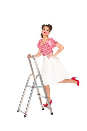 Photo pour pin up woman standing on ladder isolated on white - image libre de droit