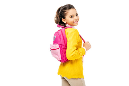 Photo pour adorable child holding pink backpack and smiling at camera isolated on white - image libre de droit