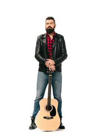 Photo for handsome rocker in black leather jacket posing with acoustic guitar, isolated on white - Royalty Free Image