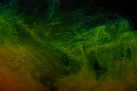 Photo for abstract background with green and orange swirls of paint - Royalty Free Image