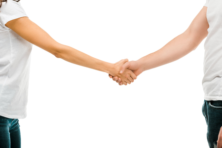 Foto de cropped shot of young man and woman shaking hands isolated on white - Imagen libre de derechos