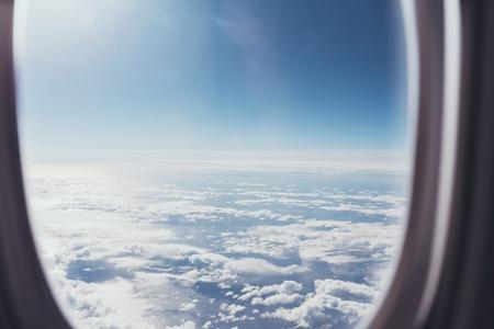 Photo pour view of blue cloudy sky from airplane window - image libre de droit