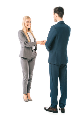 Photo for businesspeople in suits shaking hands and making deal isolated on white - Royalty Free Image