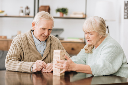 Foto de senior couple playing blocks game at home - Imagen libre de derechos