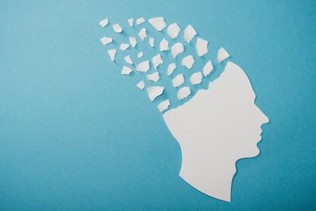 Foto de dementia symbol presented as face isolated on blue - Imagen libre de derechos