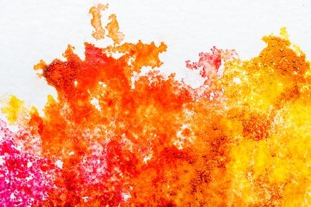 Foto de top view of orange and yellow watercolor spills on white background - Imagen libre de derechos