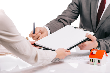 Photo for cropped view of mortgage broker and woman making deal isolated on white, mortgage concept - Royalty Free Image