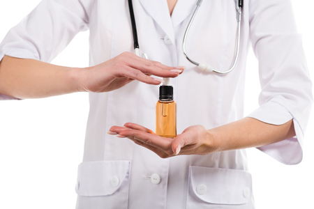Photo pour cropped view of female doctor holding bottle with cbd oil isolated on white - image libre de droit