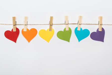 Foto de rainbow multicolored paper hearts on rope isolated on white, lgbt concept - Imagen libre de derechos