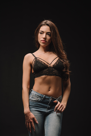 Photo for beautiful girl posing in lace bra isolated on black - Royalty Free Image