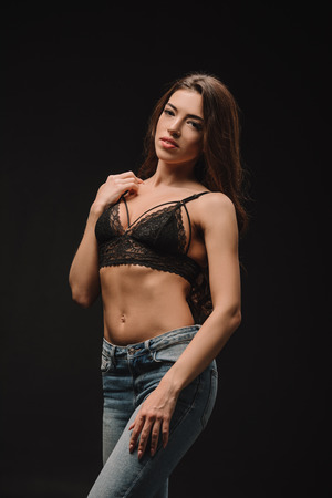 Photo for attractive girl posing in lace bra isolated on black - Royalty Free Image