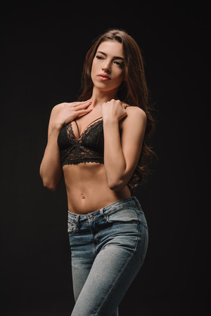 Photo for attractive young woman posing in lace bra isolated on black - Royalty Free Image