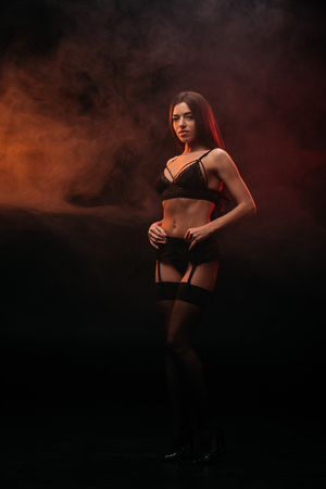 Photo for sexual young woman posing in lace lingerie in smoky room - Royalty Free Image