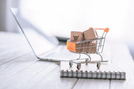 Foto de close up of packages in decorative cart on wooden desk - Imagen libre de derechos