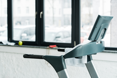 Foto per modern treadmill standing near windows in gym - Immagine Royalty Free