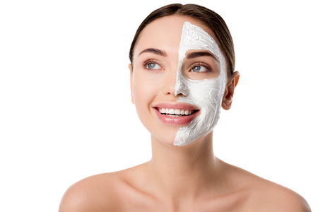 Foto de beautiful woman with facial skin care mask isolated on white with copy space - Imagen libre de derechos