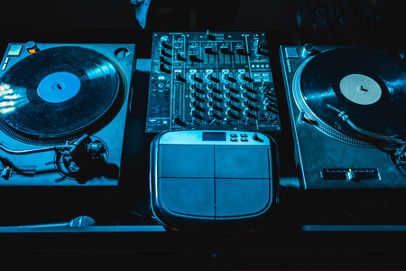 Photo for dj mixer with equalizer and vinyl records in nightclub - Royalty Free Image