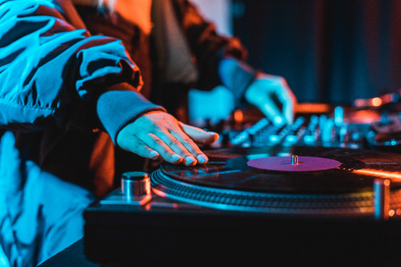 Photo for selective focus of dj woman touching vinyl record in nightclub - Royalty Free Image