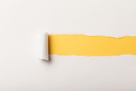 Foto de torn paper with rolled edge and copy space on yellow background - Imagen libre de derechos