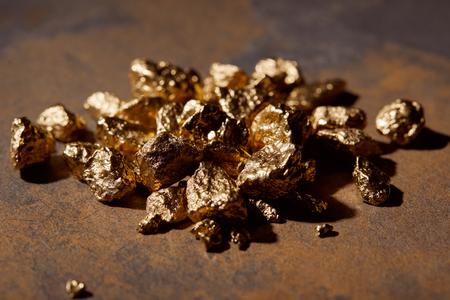 Photo pour selective focus of golden stones on marble background - image libre de droit