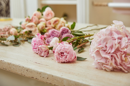 Photo for selective focus of pink roses and peonies on surface - Royalty Free Image
