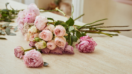 Photo for bouquet with roses and peonies on table at flower shop - Royalty Free Image