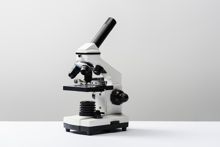 Foto de microscope on grey background with copy space - Imagen libre de derechos