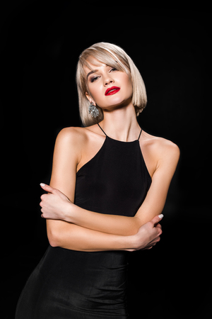 Foto de attractive glamour woman in black dress posing with crossed arms,, isolated on black - Imagen libre de derechos