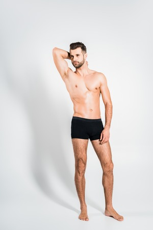 Photo for handsome shirtless man in black underwear posing on grey - Royalty Free Image