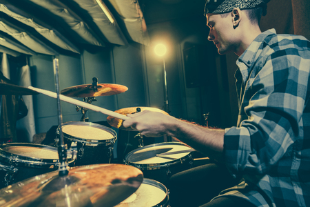 Photo for selective focus of drummer holding drum sticks while playing drums - Royalty Free Image