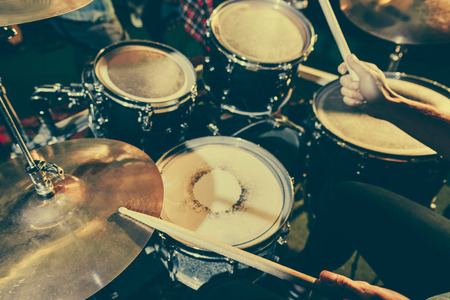 Photo for cropped view of drummer holding drum sticks while playing drums - Royalty Free Image