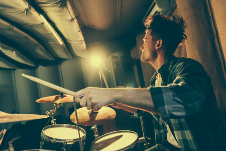 Photo for handsome musician holding drum sticks and playing drums - Royalty Free Image