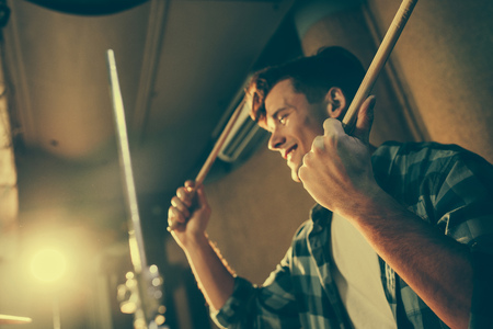 Photo for drum sticks in hands on cheerful young drummer - Royalty Free Image