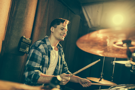 Photo for selective focus of handsome drummer holding drum sticks and playing drums - Royalty Free Image