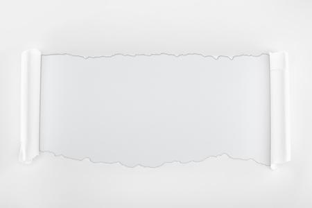 Foto de ragged textured paper with curl edges on white background - Imagen libre de derechos