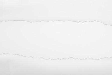 Foto de ragged textured paper with copy space on white background - Imagen libre de derechos