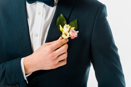 Photo for cropped view of bridegroom in black costume jacket with boutonniere isolated on white - Royalty Free Image