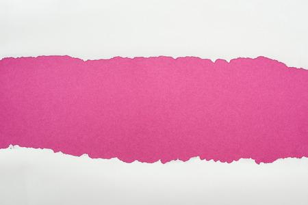 Foto de ripped white textured paper with copy space on crimson background - Imagen libre de derechos