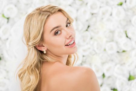 Foto de beautiful nude girl with blonde hair posing at camera on white floral background - Imagen libre de derechos
