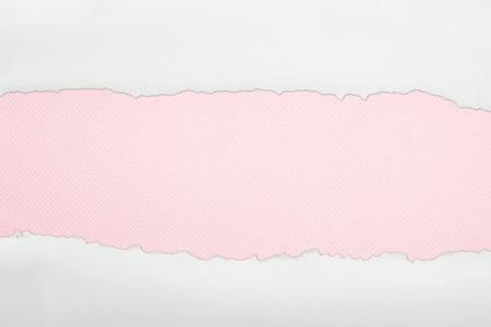 Foto de ragged white textured paper with copy space on pink background - Imagen libre de derechos