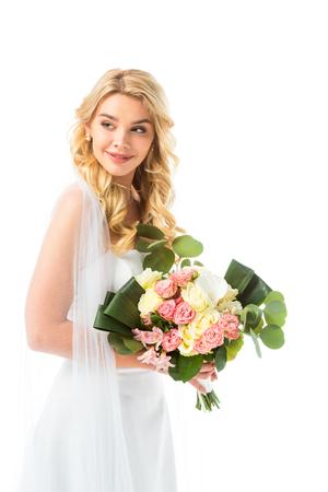Foto de beautiful bride in elegant white dress holding wedding bouquet isolated on white - Imagen libre de derechos