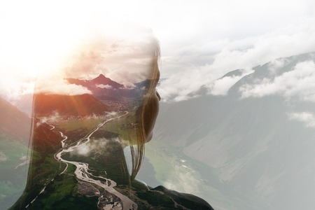 Photo pour Double exposure of girl and mountains in clouds - image libre de droit