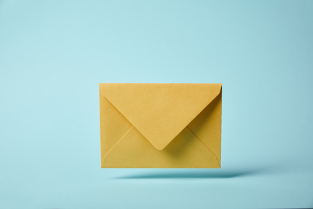 Foto de yellow and colorful envelope on blue background with copy space - Imagen libre de derechos