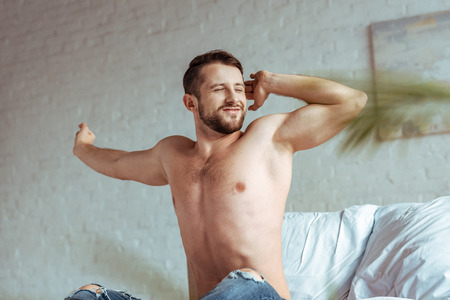 Foto de good-looking and muscular man with closed eyes and outstretched hands - Imagen libre de derechos