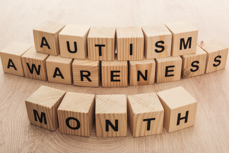 Foto de autism awareness month words made of wooden cubes - Imagen libre de derechos