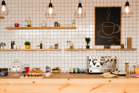 Foto für Interior of coffee shop with wooden bar counter, shelves and tiled wall - Lizenzfreies Bild