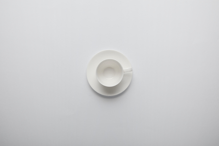 Photo pour Top view of empty cup and saucer on grey - image libre de droit
