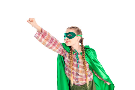 Foto de kid in superhero costume and mask with outstretched hand Isolated On White - Imagen libre de derechos