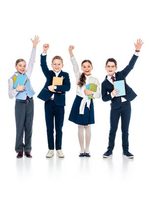 Foto de happy schoolchildren with outstretched hands holding books On White - Imagen libre de derechos