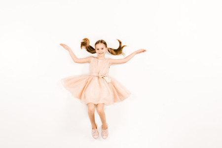 Photo for top view of smiling kid with outstretched hands looking at camera on white - Royalty Free Image